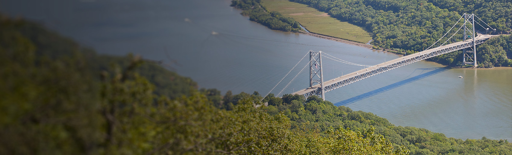 An aerial view of a bridge over a large river.