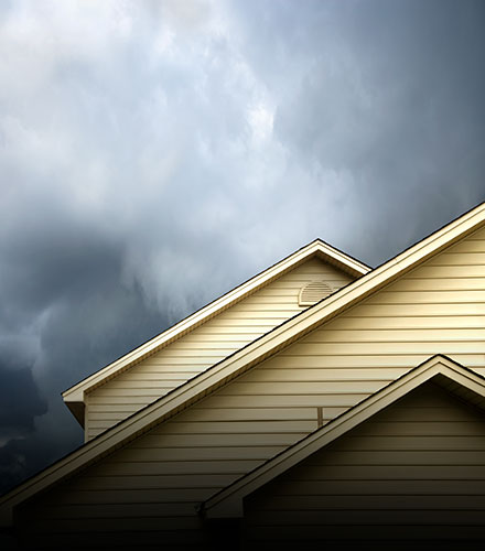 storm clouds above house