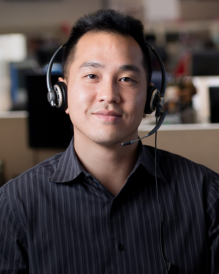 An Orange and Rockland customer service representative wearing a headset.
