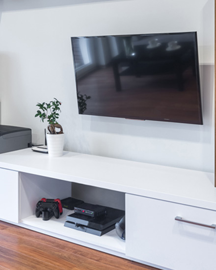 A flat screen TV and other home electronics in a living room.