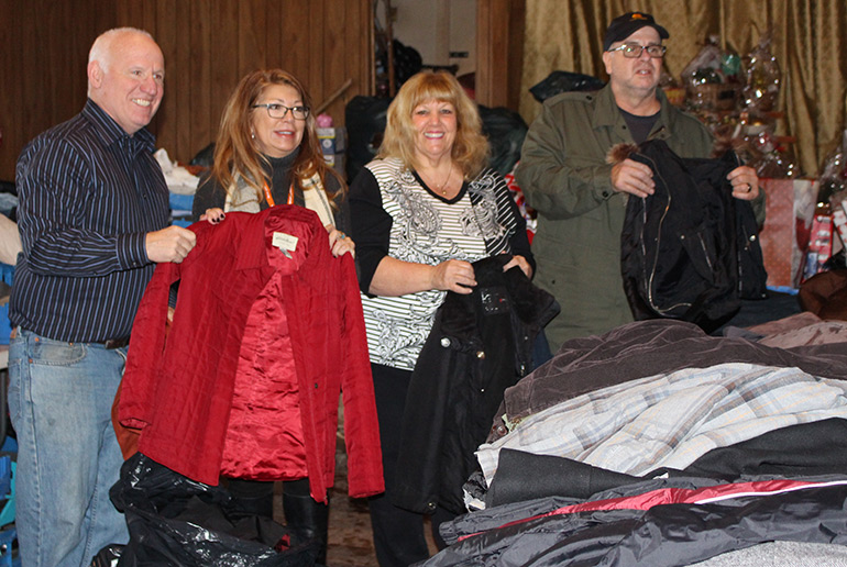 Pictured here, from left, during the coat delivery, are: O&R's Kevin McPartland and Aileen Sullivan with Easter Seals Community Outreach Coordinator Barbara Kuczyra and O&R's Jim Carbone.