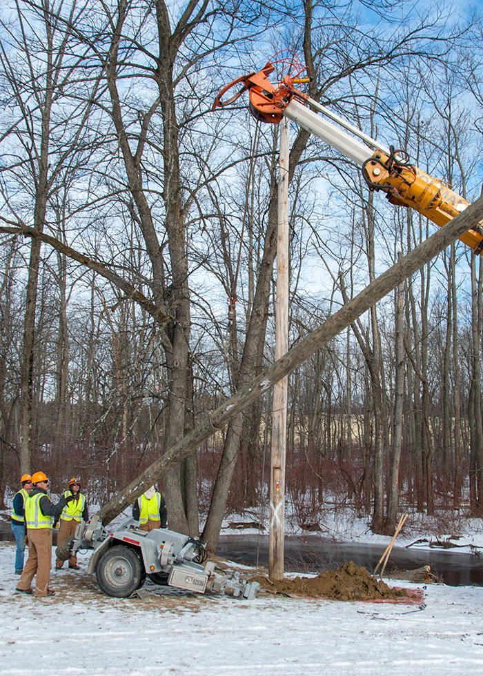 replacing utility pole during cold weather