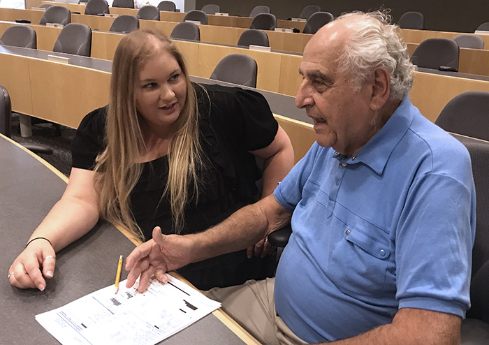 Pictured here at RCC's Technology Building, from left, O&R's Lisa Welsh goes over the monthly bill with Richard Weinberger of Wesley Hills.