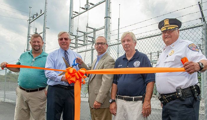 O&R and Town of Deerpark leaders made it official last week by cutting the ribbon for the dedication of O&R's new $26-million Deerpark electric substation. Pictured from left: Town Highway Superintendent Ed Hughson, Town Supervisor Gary Spears, O&R's Vice President – Operations Francis W. Peverly, Town Director of Emergency Management Jack Flynn and Town Police Chief Richard Sztyndor.
