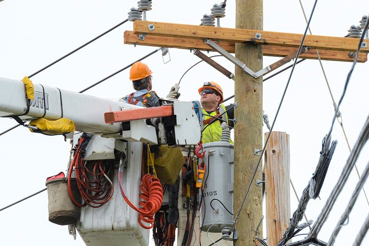 Lineman in bucket, working on distribution line.