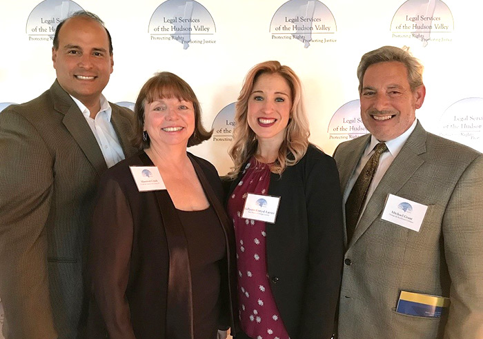 Pictured, from left, are: O&R's Eric Fuentes, honorees Maureen Crush and Kellyann Kostyal-Larrie, and O&R's Michael Grant.