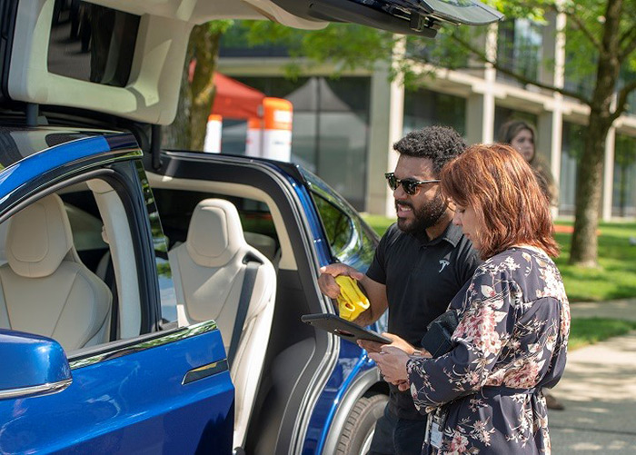 "Taking a Tesla Tour - A Tesla sales representative, left, describes the many wonders of the ""quiet car"" to one of the many people who attended the most recent O&R Electric Car Guest Drive event in Pearl River."