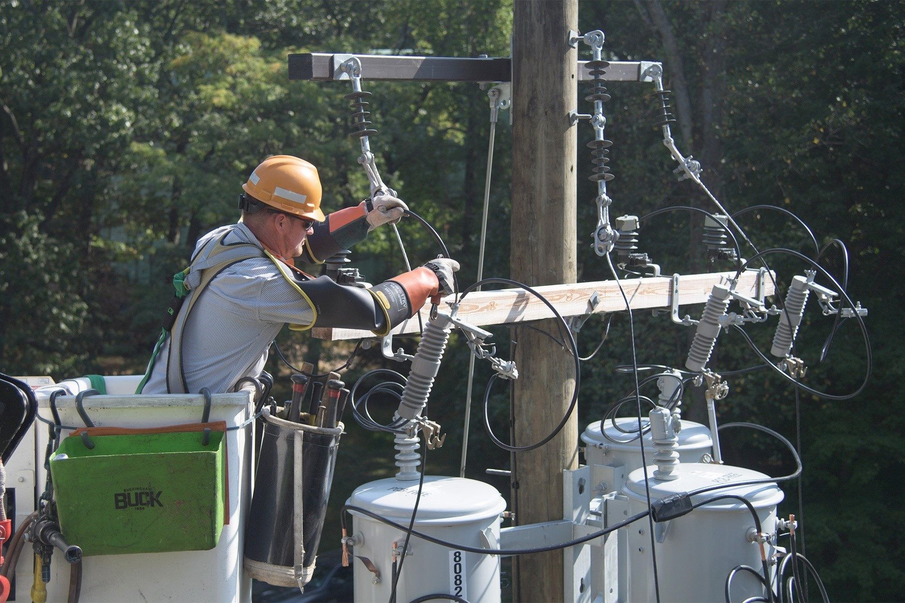 Lineman working on electric service line.