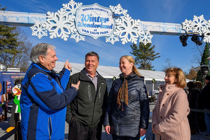 Joining Tedesco and enjoying the celebration, are: Bergen County Freeholder Steven A. Tanelli, center, and Rockland Electric Company's Kate Wysokowski, near right, and Linda Feger, far right.