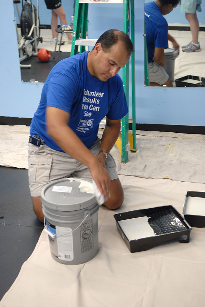 O&R employee painting for United Way Day of Caring